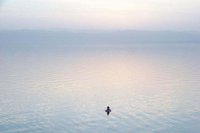 Man is Floating in the Dead Sea
